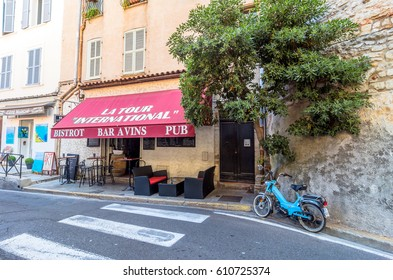 Antibes, France - June 29, 2016: day view of typical street with bistrot in Antibes, France. Antibes is a popular seaside town in the heart of the Cote d'Azur.