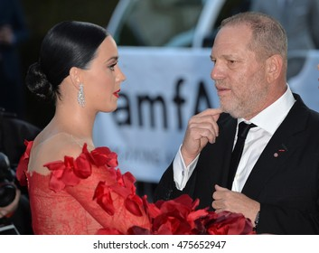 ANTIBES, FRANCE - MAY 19, 2016: Singer Katy Perry & Harvey Weinstein at the amfAR Cinema Against AIDS Gala 2016 at the Hotel du Cap d'Antibes.