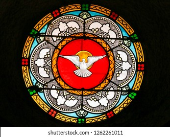 Antibes, France - November 16, 2018: Stained Glass in the Church of Antibes, France, depicting a Dove, symbol of the Holy Spirit