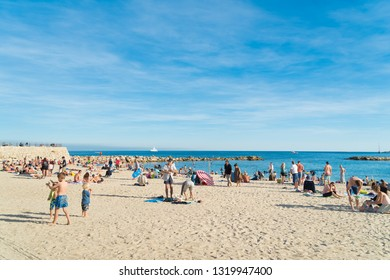 ANTIBES, FRANCE - OCTOBER 25, 2017:  Sunny beach of Antibes with lots of unknown people enjoying the autumn sun