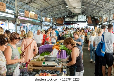 ANTIBES, FRANCE - SEPTEMBER 15, 2018: The Provencal Market, the Marché Provençal, in old Antibes in September, with stalls selling fruit and vegetables.