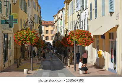 Antibes, France - September 21 2017: Street & tourists  in Autumn, Southern Provence.