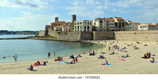 Antibes, France - September 22, 2017: People Sunbathing on Antibes Beach , Cote d'azur, provence france