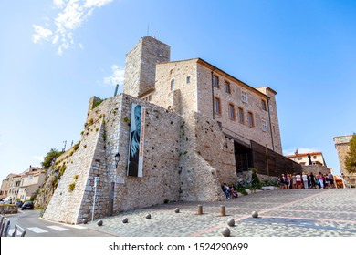 ANTIBES, FRANCE - September 25, 2019: Grimaldi Castle facade  in Antibes, France. Grimaldi Castle shelter the Picasso Museum, where are exposed paintings and ceramics of Pablo Picasso