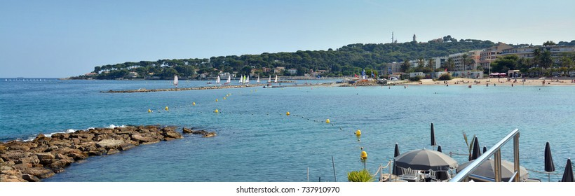 Antibes, France - September 26, 2017: People Sunbathing at Antibes Beach on a hot Autumn day.