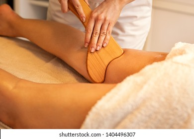 Anti-cellulite Madero Therapy massage done with specially designed wooden tool to eliminate accumulated toxins