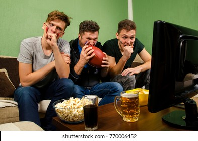 Anticipation, nervous football fans biting nails