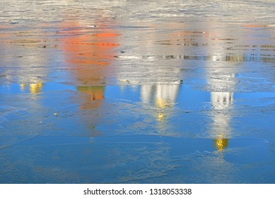 Anticipation of spring. Reflection of Kremlin cathedrals and towers in waters of Moscow River. Russia