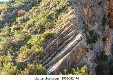 Anticline. Curious rock formations on the side of a mountain.