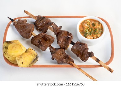 anticuchos, Peruvian cuisine, grilled skewered beef heart meat with boiled potato