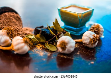 Antidote for wounds and cuts on wooden surface i.e. Devil's dung powder well mixed with garlic.Entire raw ingredients present on the surface.