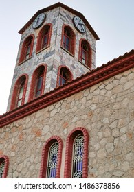antient clock tower on the church in greece