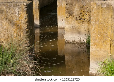Anti-erosion system in the floodplain. Protective communications from natural disasters. Concrete blocks protect the bridge from destruction by water.