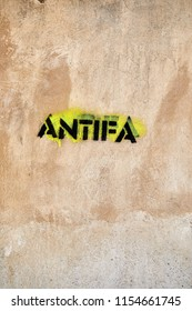 ANTIFA logo stencilled on a wall.