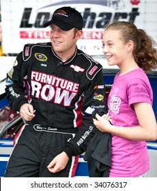ANTIGONISH, NOVA SCOTIA - JULY 18: Maritime Pro Stock Tour race car drivers take part in the IWK 250 race on July 18, 2009 in Antigonish, Nova Scotia. Here NASCAR driver Regan Smith meets a fan.