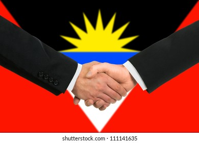 The Antigua and Barbuda flag and business handshake