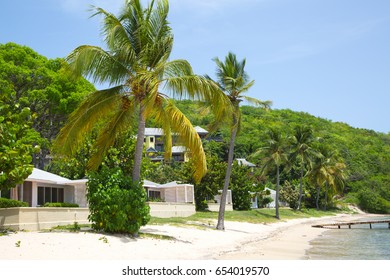 Antigua, Caribbean islands, English Harbour - May 20, 2017:  Galleon beach view with holidays houses