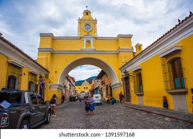 Antigua, Central Highlands/ Guatemala - March 22, 2019: Tourists at he Santa Catalina Arch is one of the distinguishable landmarks in Antigua Guatemala, Guatemala, located on 5th Avenue North.