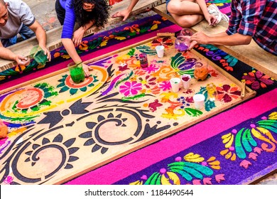 Antigua, Guatemala -  April 13, 2017: Making dyed sawdust Holy Thursday procession carpet in colonial town & UNESCO World Heritage Site with most famous Holy Week celebrations in Latin America.