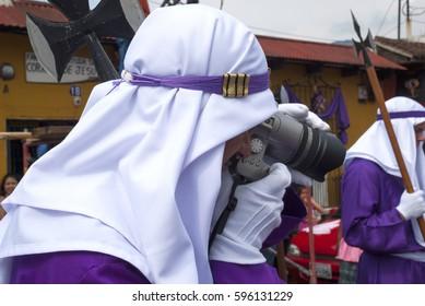 ANTIGUA GUATEMALA - APRIL 22, 2011: Easter week in La Antigua Guatemala, procession, Cucuruchos, vegetable rugs on cobbled streets. EDITORIAL.