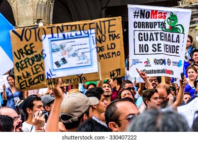 """Antigua, Guatemala - August 27, 2015: Locals protest against government corruption & demand resignation of President Otto Perez Molina. Sign reads """"No more corruptionists. Guatemala isn't for sale"""""""
