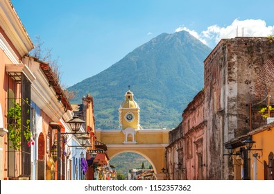 Antigua Guatemala, classic colonial town with famous Arco de Santa Catalina and Volcan de Agua behind