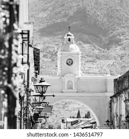Antigua Guatemala, classic colonial town with famous Arco de Santa Catalina and Volcan de Agua behind in stunning black and white