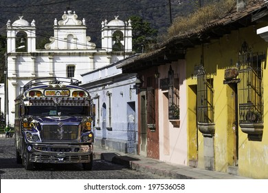 "ANTIGUA, GUATEMALA - DECEMBER 4: A typical ""Chicken Bus"" travellng between Antigua and Guatemala City. This is one of the busiest routes in Guatemala. Antigua, Guatemala - December 4, 2013"