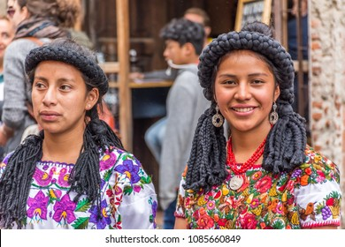 Antigua, Guatemala - January 21, 2017: Maya beauty pageant princesses from Quiche dressed in traditional costume in the street of UNESCO World Heritage Site