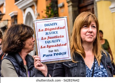 Antigua, Guatemala - January 21, 2017: Woman holds sign in peaceful Women's March as part of global protest protecting women's rights & other causes