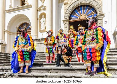 Antigua, Guatemala -  July 25, 2017: Folk dancers wear traditional masks & costumes on St Jame's Day, Antigua's patron saint day, outside cathedral