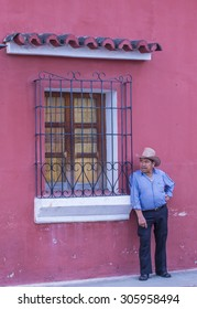 ANTIGUA , GUATEMALA - JULY 30 : Guatemalan Man at the street of Antigua Guatemala on July 30 2015. The historic city Antigua is UNESCO World Heritage Site since 1979.