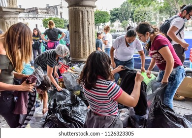 Antigua,, Guatemala -  June 5, 2018:  Volunteers sort & load supplies to take to area affected by eruption of Fuego (fire) volcano on June 3. Official figures say 113 people died & 197 missing.