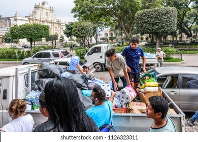 Antigua,, Guatemala -  June 5, 2018:  Volunteers load supplies outside town hall to take to area affected by eruption of Fuego (fire) volcano on June 3. 113 people died & 197 missing.