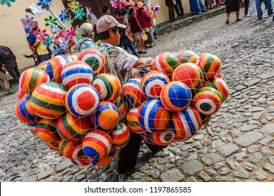 Antigua, Guatemala - Mar 1, 2015: Street sellers follow Lent procession in colonial town & UNESCO World Heritage Site with most famous Holy Week celebrations in Latin America.