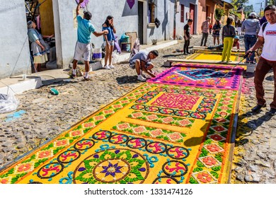 Antigua, Guatemala -  March 11, 2018: Making dyed sawdust Lent carpet in town with most famous Holy Week celebrations in Latin America