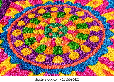 Antigua, Guatemala -  March 11, 2018: Dyed sawdust Lent procession carpet detail in town with most famous Holy Week celebrations in Latin America