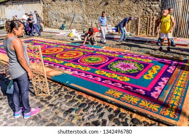 Antigua, Guatemala -  March 11, 2018: Making dyed sawdust Lent carpet destroyed moments later by passing processions in town with famous Holy Week celebrations