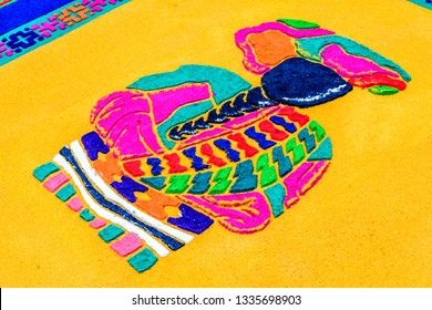 Antigua, Guatemala -  March 18, 2018: Dyed sawdust Lent procession carpet detail of Maya lady in town with most famous Holy Week celebrations in Latin America