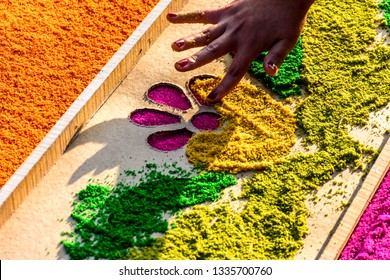 Antigua, Guatemala -  March 18, 2018: Decorating dyed sawdust Lent procession carpet using stencil in town with most famous Holy Week celebrations in Latin America