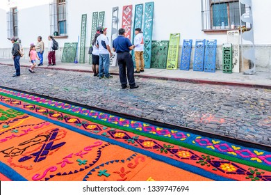 Antigua, Guatemala -  March 18, 2018: Selling stencil designs in street for making dyed sawdust Lent procession carpets in town with famous Holy Week celebrations