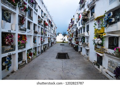 Antigua, Guatemala - March 20, 2018: Walls of tombs with flowers at the San Lazaro Cemetery