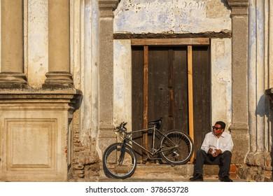 ANTIGUA GUATEMALA / GUATEMALA - MARCH 2013: Man having rest in the historic center of Antigua Guatemala