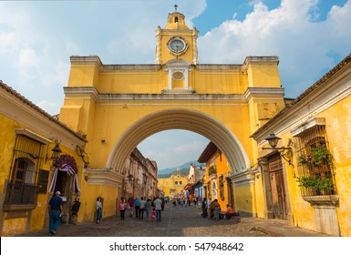 ANTIGUA, GUATEMALA - MARCH 25 2013: The famous arch of the city center of Antigua together with tourists and vendors of arts and crafts.