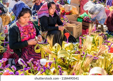 Antigua, Guatemala -  March 25, 2018: Local Maya women make Palm Sunday sprays of leaves & flowers in UNESCO World Heritage Site with most famous Holy Week celebrations in Latin America.