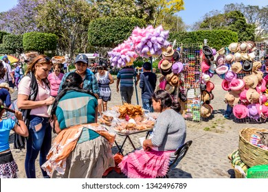 Antigua, Guatemala -  March 25, 2018: Palm Sunday street vendors by central park in town with famous Holy Week celebrations