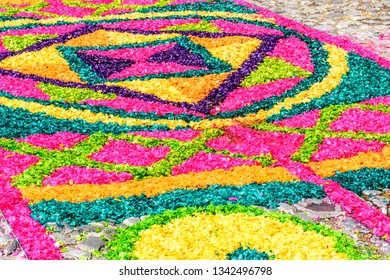 Antigua, Guatemala -  March 25, 2018: Dyed sawdust Palm Sunday carpet destroyed moments later by passing processions in town with famous Holy Week celebrations