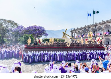 Antigua, Guatemala -  March 25, 2018: Palm Sunday procession in front of City Hall & central park in UNESCO World Heritage Site with most famous Holy Week celebrations in Latin America.