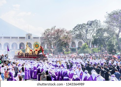 Antigua, Guatemala -  March 25, 2018: Palm Sunday procession in front of cathedral & central park in UNESCO World Heritage Site with most famous Holy Week celebrations in Latin America.