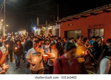 ANTIGUA, GUATEMALA - MARCH 27, 2016: Participants of the nighttime procession on Easter Sunday in Antigua Guatemala city.